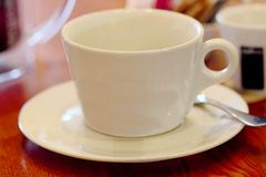 White cup. In coffee shop Royalty Free Stock Photo