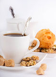 White cup of coffee with a silver spoon Stock Images