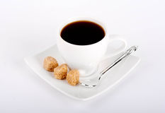 White cup of coffee with a silver spoon Royalty Free Stock Photography