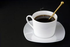 White cup of coffee with smoke, teaspoon isolated Royalty Free Stock Photos