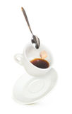 White cup of coffee with spoon Stock Images