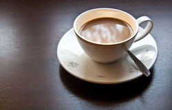 White Cup of coffee on Wooden Table Stock Photos