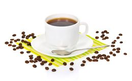 White cup of coffee on striped napkin with grains Stock Photography