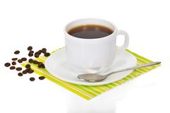 White cup of coffee on a striped napkin Royalty Free Stock Photography