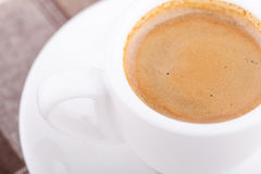 White cup of coffee on tablecloth. Close up white cup of coffee on tablecloth Royalty Free Stock Photos