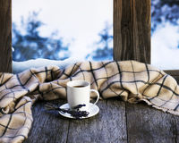 White cup of coffee or tea, lavender flowers and woolen plaid. White cup of coffee or tea, lavender flowers and woolen plaid located on stylized wooden window Stock Photos