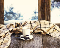 White cup of coffee or tea, lavender flowers and woolen plaid. White cup of coffee or tea, lavender flowers and woolen plaid located on stylized wooden window Royalty Free Stock Photos