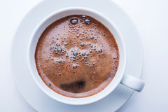 White cup of coffee. Top view. White cup of coffee with roasted coffee beans Royalty Free Stock Photography