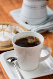 White cup of coffee with turkish delight in the background Royalty Free Stock Photos