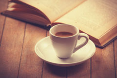 White cup of the coffee and vintage book. Royalty Free Stock Photo