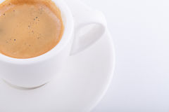 White cup of coffee on white background. Close up white cup of coffee on white background Royalty Free Stock Images