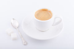 White cup of coffee on white background. White cup of coffee with sugar and spoon on white background Royalty Free Stock Photo