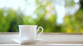 White Cup of Coffee on the Windowsill