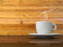 A white cup of coffee on wood table Stock Image