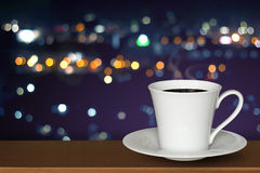 White cup of coffee on wooden desk Royalty Free Stock Photo
