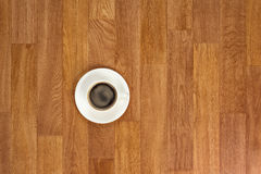 White cup of coffee on wooden table. Royalty Free Stock Photography