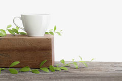White cup coffee on wooden top table isolated Royalty Free Stock Image