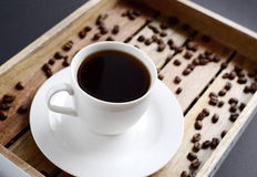 White cup of coffee on the wooden tray Stock Photos