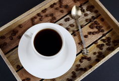 White cup of coffee on the wooden tray Stock Images