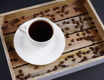 White cup of coffee on the wooden tray Stock Photography