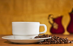 White cup of coffee on a yellow background Royalty Free Stock Photo