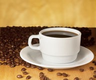 White cup of coffee on a yellow background Stock Images