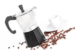White cup and coffeepot and coffee beans Stock Photography