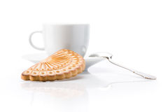 White cup and cookie over white background. White cup and cookie close up shoot over white background royalty free stock photography