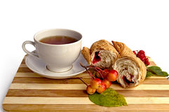 White cup and a croissant on the board Stock Photography