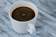 White cup with dark coffee. Stock Image