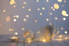 white cup with decorations on white wooden table royalty free stock image