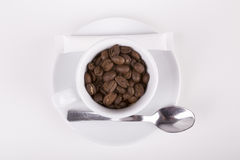 White cup of delucious coffee taken from top. Placed on white table Royalty Free Stock Image