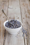 A white cup of dried lavender with stainless tea spoon Royalty Free Stock Images