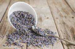 A white cup of dried lavender with stainless tea spoon Royalty Free Stock Photos