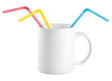 White cup with a drinking straw Royalty Free Stock Photos
