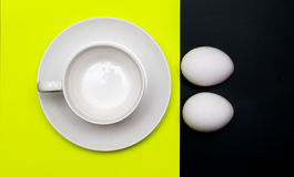 White cup and eggs for breakfast Royalty Free Stock Image