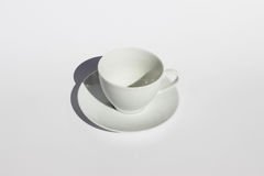 White Cup. An empty  white coffe cup on a white background Royalty Free Stock Images