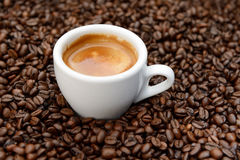 White cup espresso on coffee beans Royalty Free Stock Image