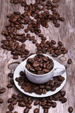 White cup of espresso full of coffee beans Royalty Free Stock Image