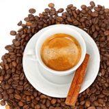 The white cup of espresso with grains Royalty Free Stock Photos