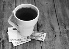 White cup and euro money, romantic  beautiful morning Royalty Free Stock Photos