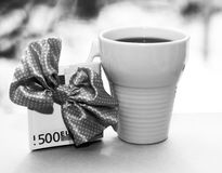 White cup and euro money, romantic Royalty Free Stock Images