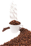White cup filled with coffee beans Stock Photography