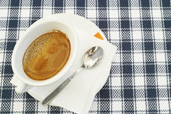 White cup filled with coffee Stock Photos