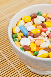 White cup filled with medicine pills Stock Image