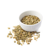 White cup filled with pumpkin seeds Stock Photography