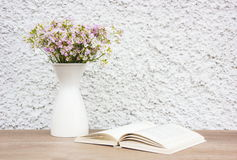 White cup and flowers. White cup and vase flowers Royalty Free Stock Images