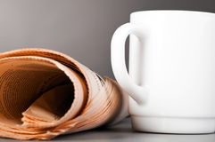 White cup and folded newspaper Stock Photos