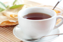 White cup of fragrant tea Stock Photos