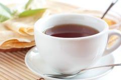 White cup of fragrant tea. Strong black tea Stock Photos